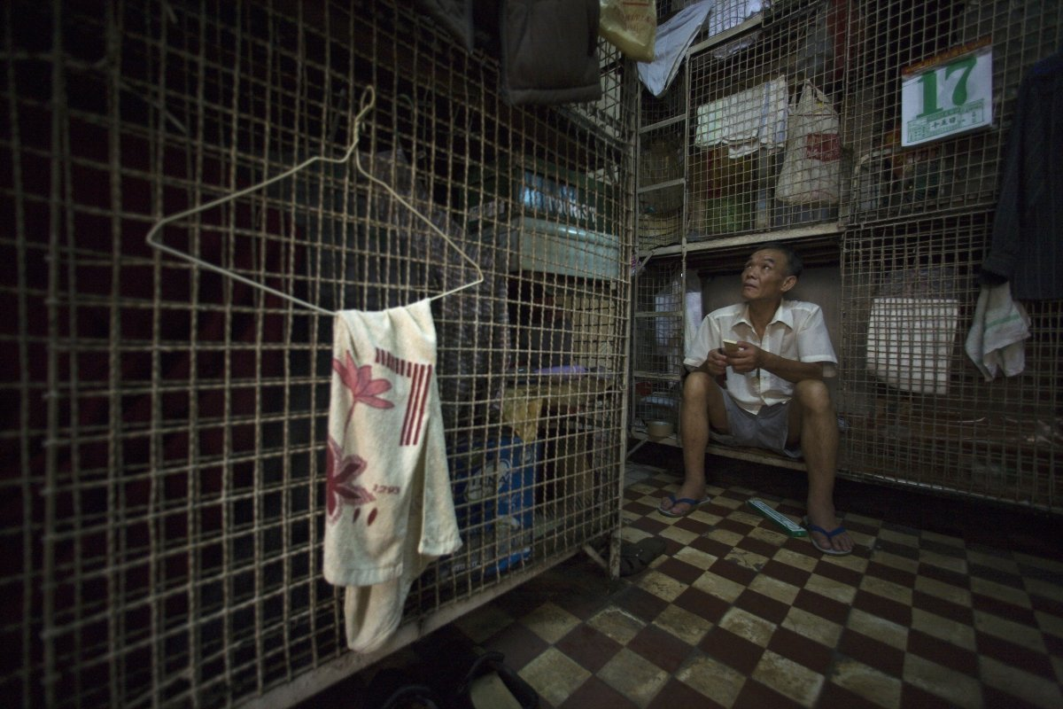hundreds-of-elderly-men-such-as-kong-siu-kau-live-in-these-conditions-in-one-such-building-up-to-12-men-can-live-together-in-tightly-packed-cages
