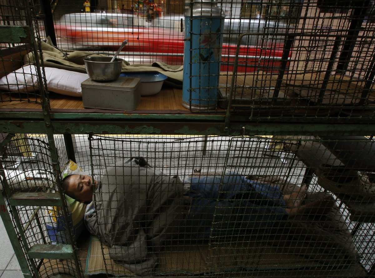 until-the-hong-kong-government-acknowledges-the-danger-of-the-conditions-however-the-best-residents-can-do-is-protest-the-cages-are-where-many-will-live-out-their-remaining-years