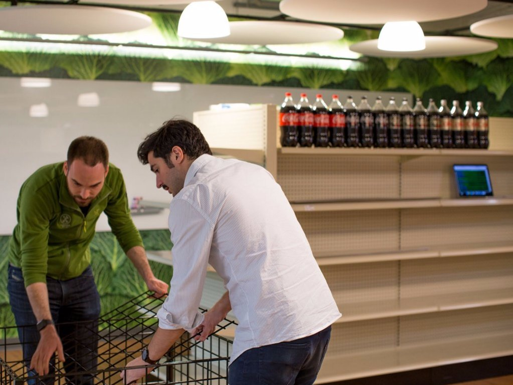 at-the-start-of-the-hackathon-ferreri-and-mullen-had-to-quickly-order-and-assemble-grocery-store-shelving-then-they-had-to-purchase-a-bunch-of-food-to-start-lining-the-shelves