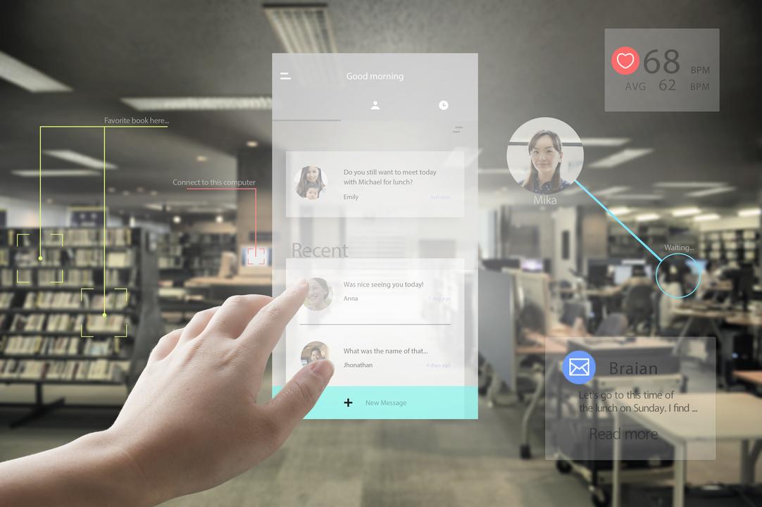 未来のオフィスでバーチャルタッチパネルでメッセージを送る人