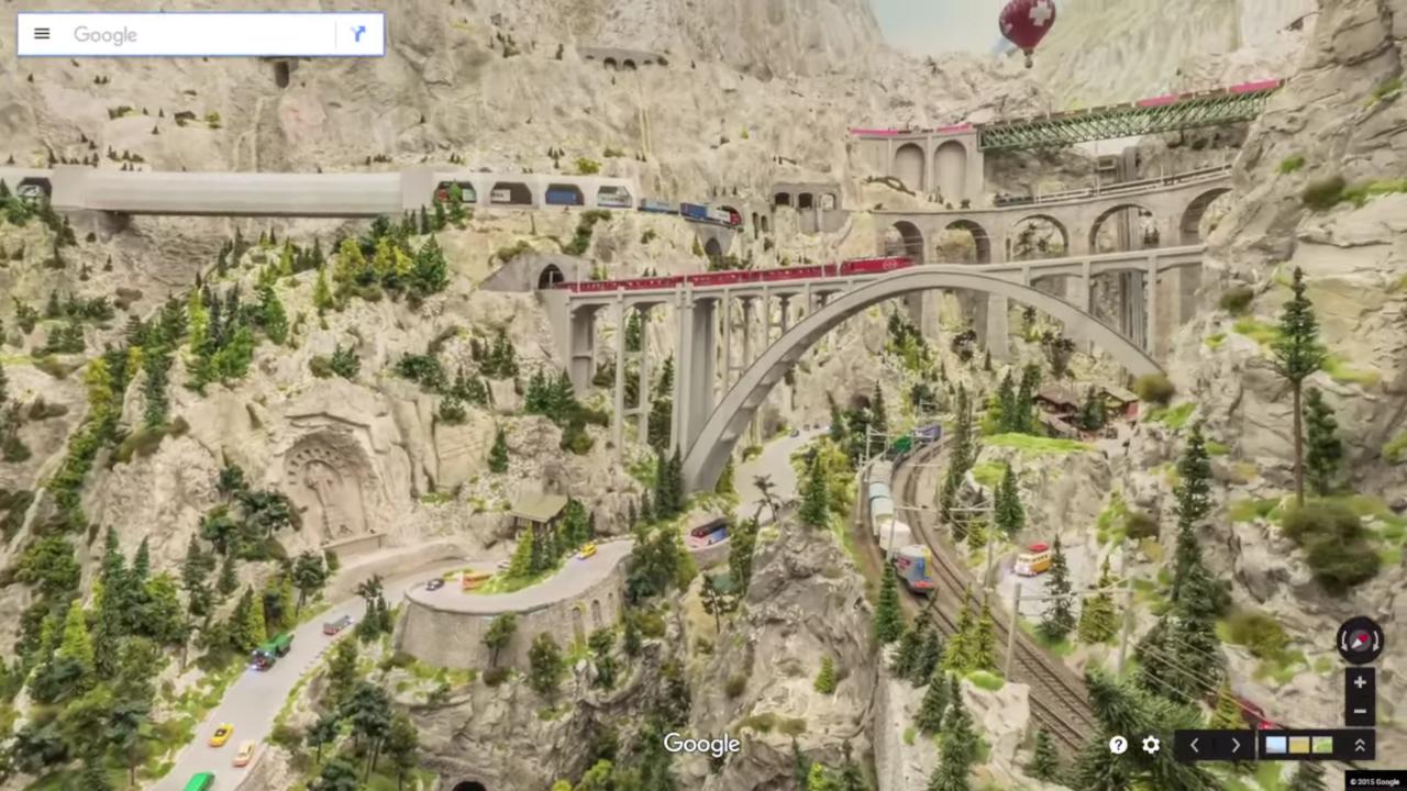 岩肌が露出した峡谷。鉄道橋を渡っていく電車など