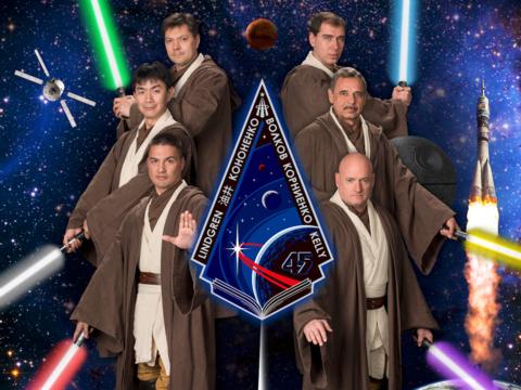 ジェダイになりきった宇宙飛行士たちのポスター