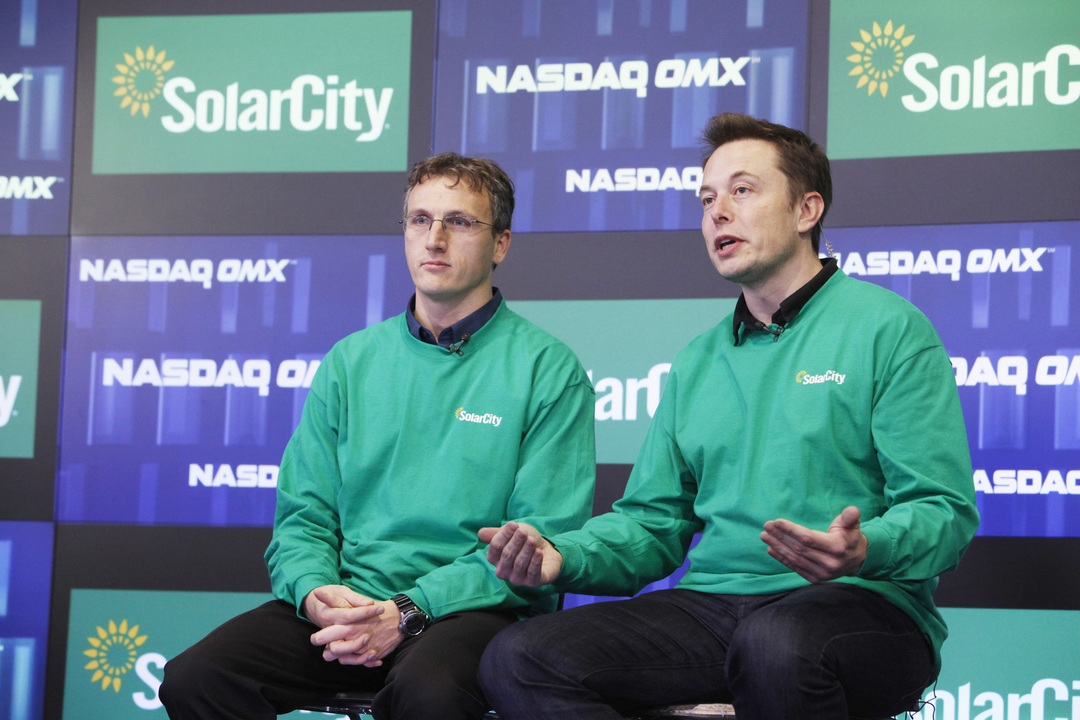 SolarCity cofounder Lyndon Rive (left) and Musk