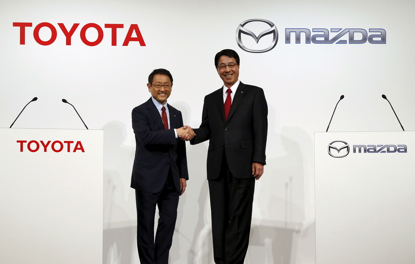 Toyota Motor Corp President Akio Toyoda (L) and Mazda Motor Corp President and CEO Masamichi Kogai