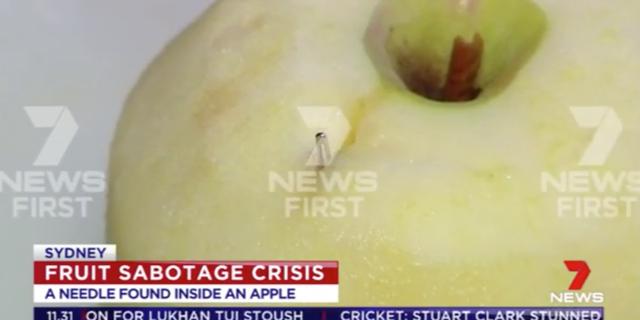 りんごに刺さる縫い針