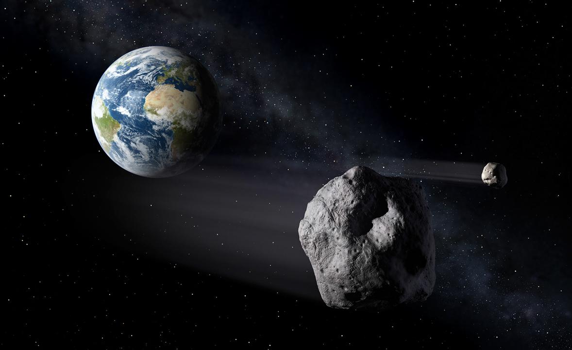 地球の近くを通過する地球近傍天体(NEO)の想像図。
