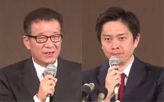 記者会見する松井一郎大阪市長(左)と吉村洋文大阪府知事