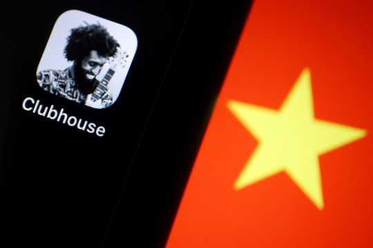 The social audio app Clubhouse is pictured near a star on the Chinese flag.