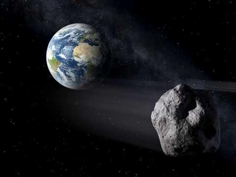 地球に接近する小惑星の想像図。