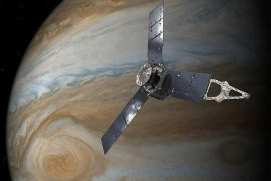 An illustration of NASA's Juno spacecraft in orbit around Jupiter.