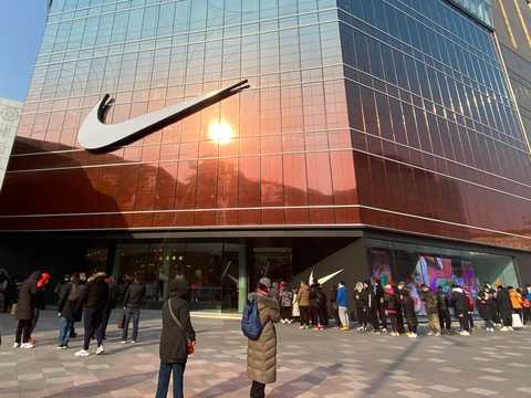 Customers lined up outside the Nike flagship store on the opening day at Wangfujing Street on January 20, 2021 in Beijing, China.
