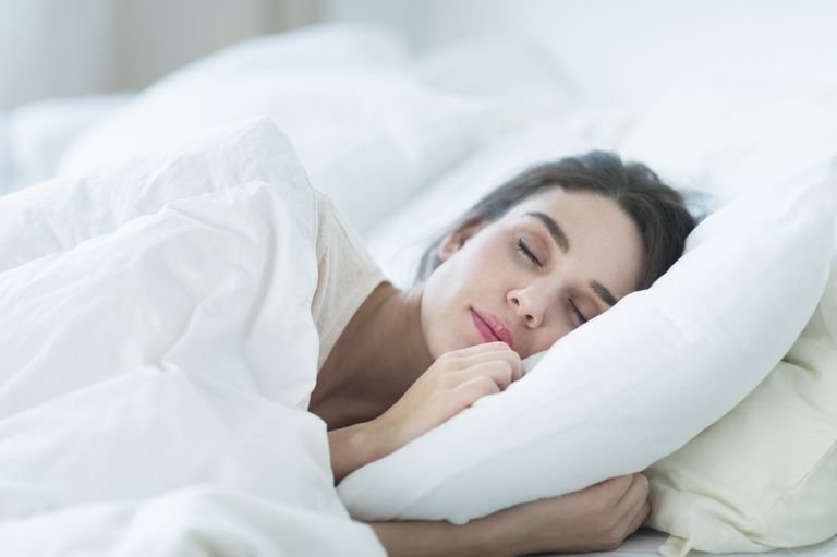 new-jersey-jersey-city-woman-sleeping-in-bed-royalty-free-image-167456327-1533330140