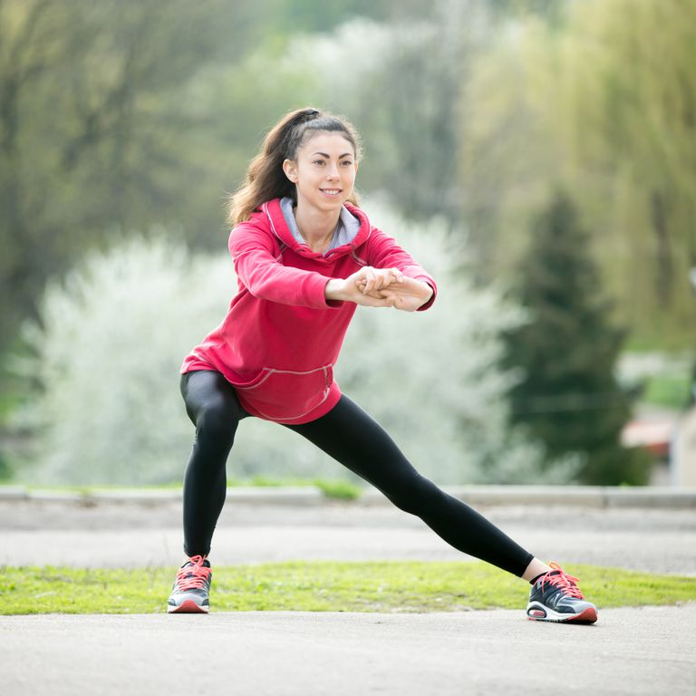 runner-woman-doing-side-lunges-before-jogging-royalty-free-image-531912858-1540587874