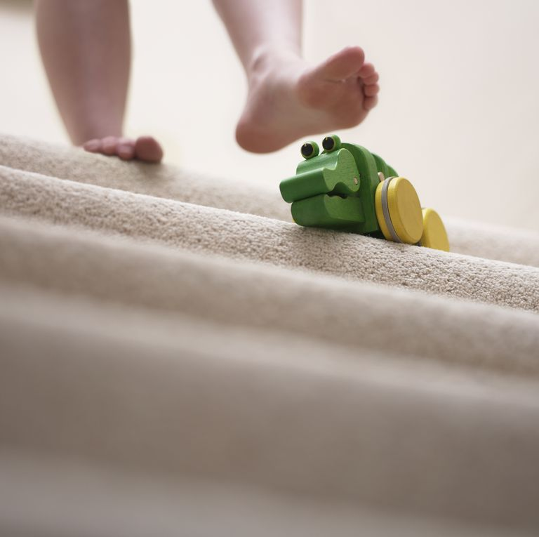 woman-about-to-slip-on-toy-left-on-staircase-royalty-free-image-90201424-1540588673