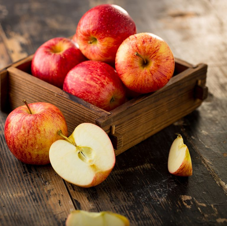 apple-isolated-on-wood-background-royalty-free-image-614871876-1541431670