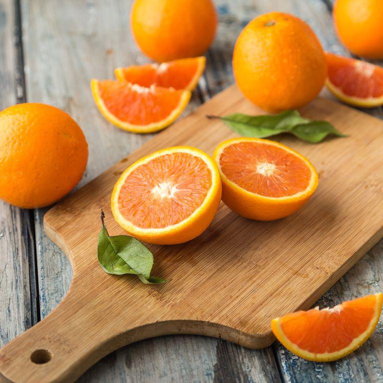 orange-isolated-on-wood-background-royalty-free-image-618848774-1541440364