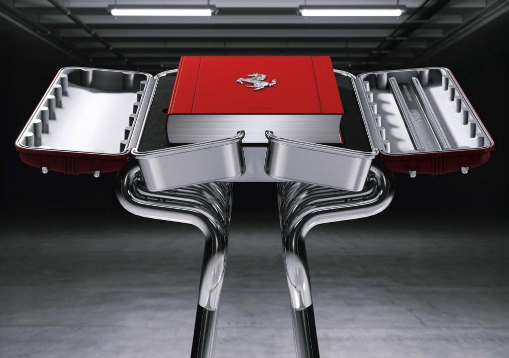 3万ドルもするFerrariの限定写真集。エンジン型のケースとエキパイのスタンド付き