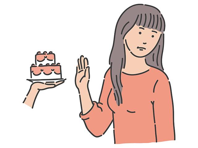 ケーキを断る女性のイラスト