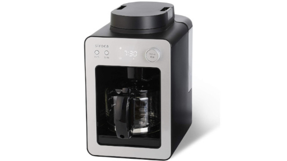 Photo of Compact coffee maker with built-in mill. Freshly ground coffee with a timer
