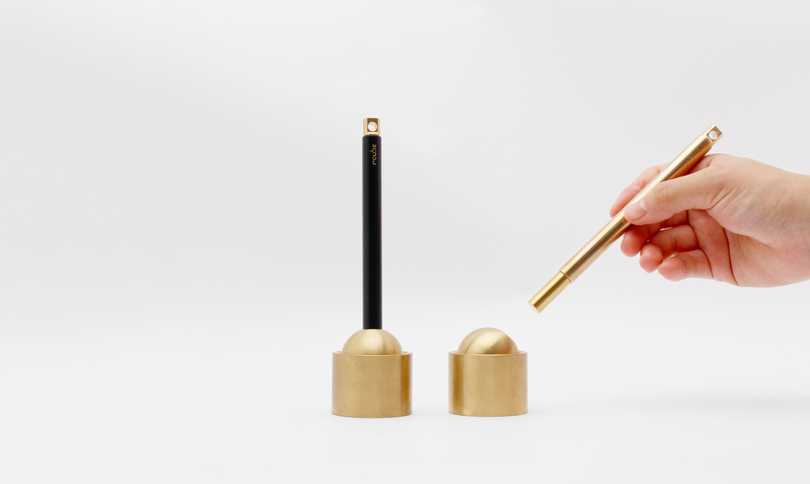 "Photo of It's almost like a magic trick. Brass pen and stand ""INVISI"" that colors everyday with a little trick"