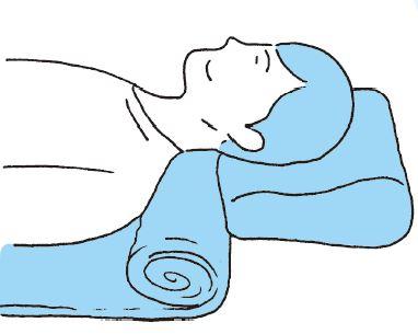 枕の下にバスタオルを入れて調整する