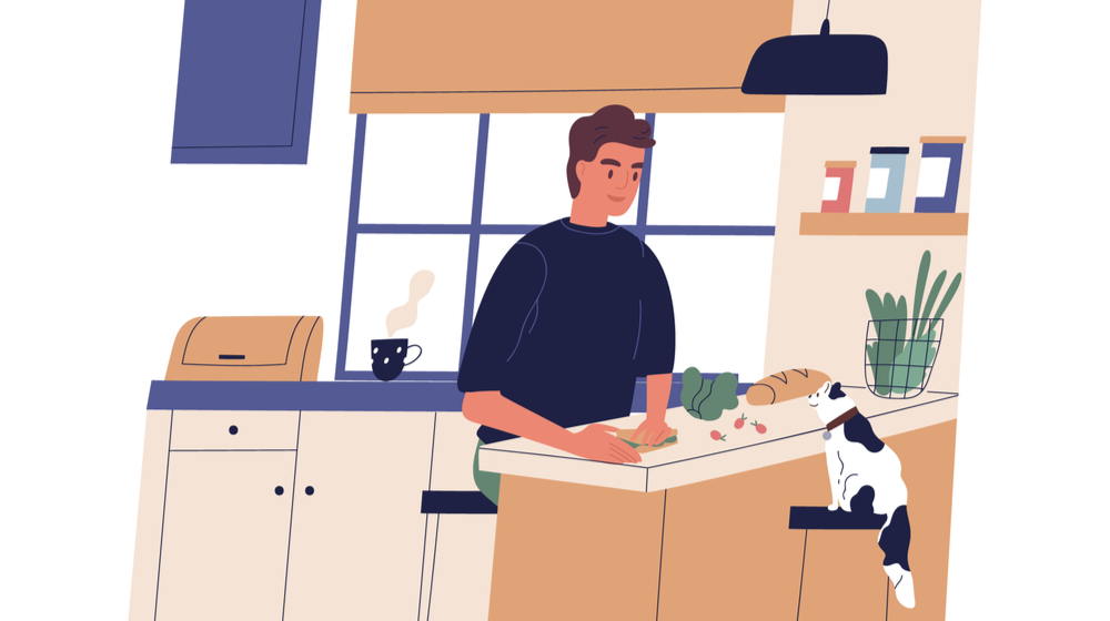 料理を作る男性と猫