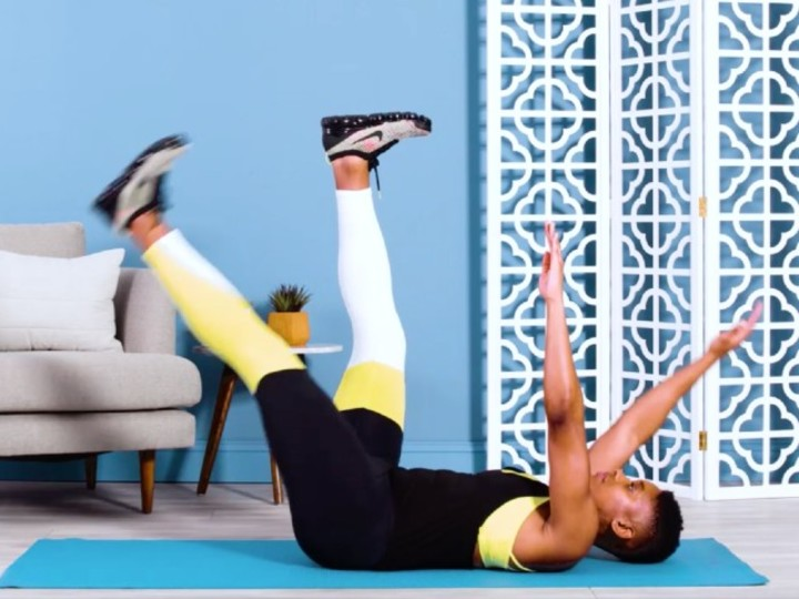 """Photo of Core exercise with """"dead bug"""", a laying exercise that alternately moves limbs"""