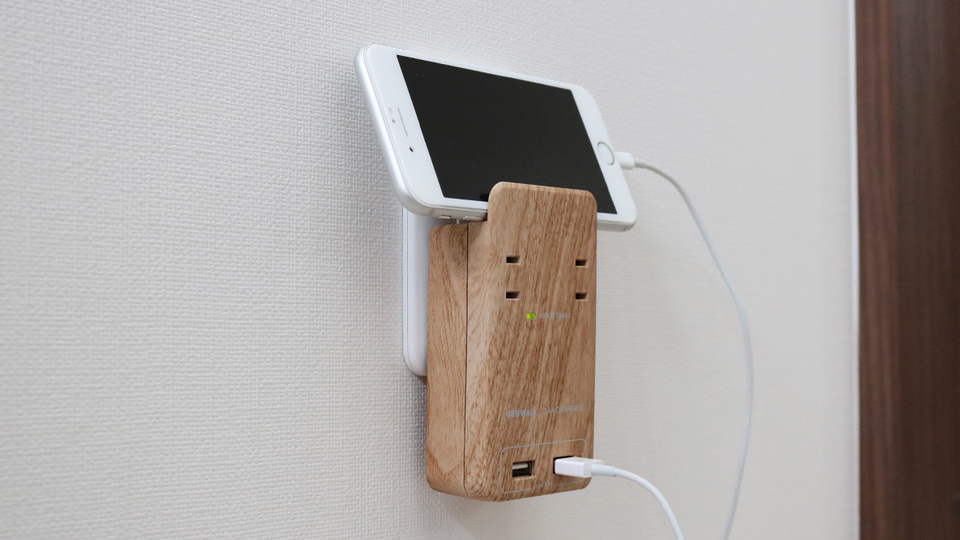 Photo of The cord clutter has been eliminated with the power plug that can also be used as a smartphone stand!