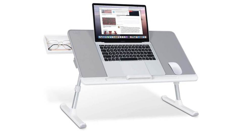 Photo of A folding table with a smartphone storage that allows you to comfortably use your PC on the bed or on the sofa