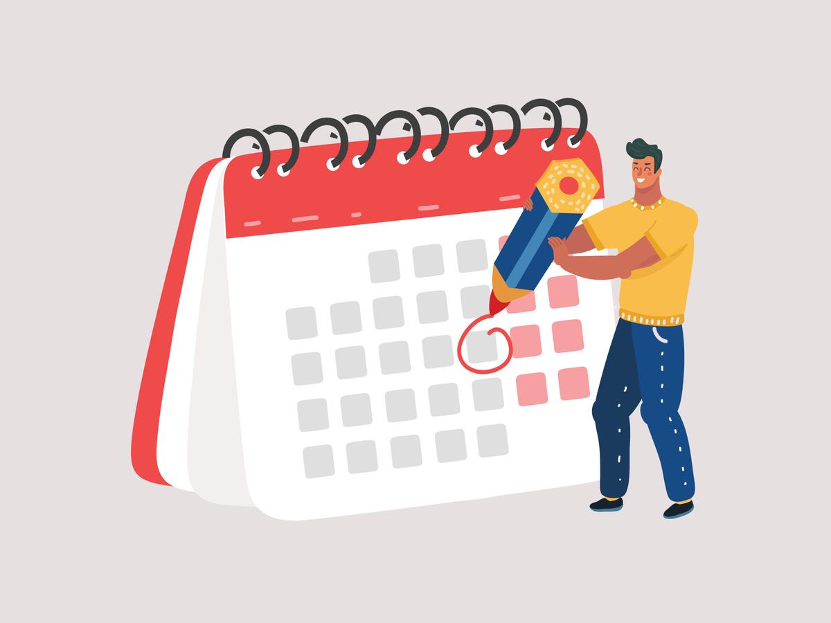 カレンダーに丸を付ける男性