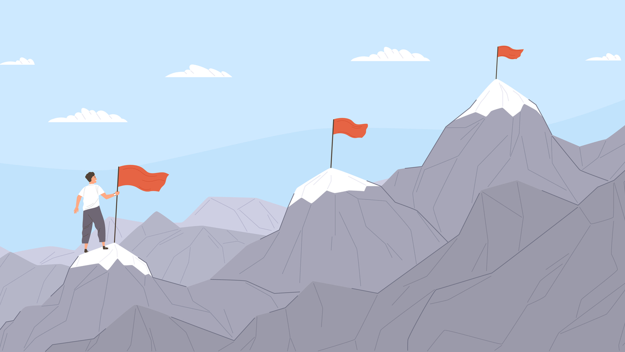 山頂で目的地を見据える男性