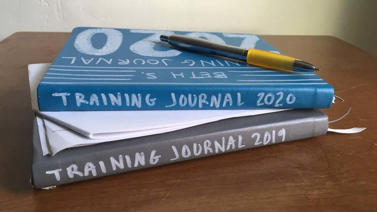 トレーニング日記を積み重ねたノート