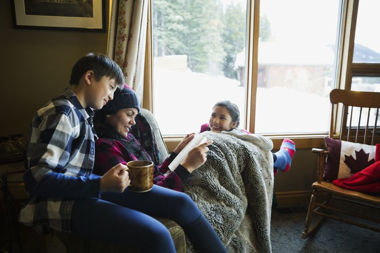 family-reading-and-relaxing-in-lodge-living-room-royalty-free-image-542092765-1533234107