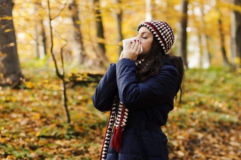 woman-sneezing-in-handkerchief-at-autumn-royalty-free-image-524051849-1533233126
