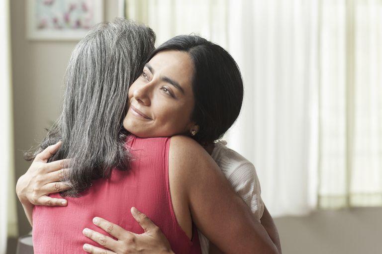 smiling-daughter-hugging-mother-royalty-free-image-726776227-1535640366
