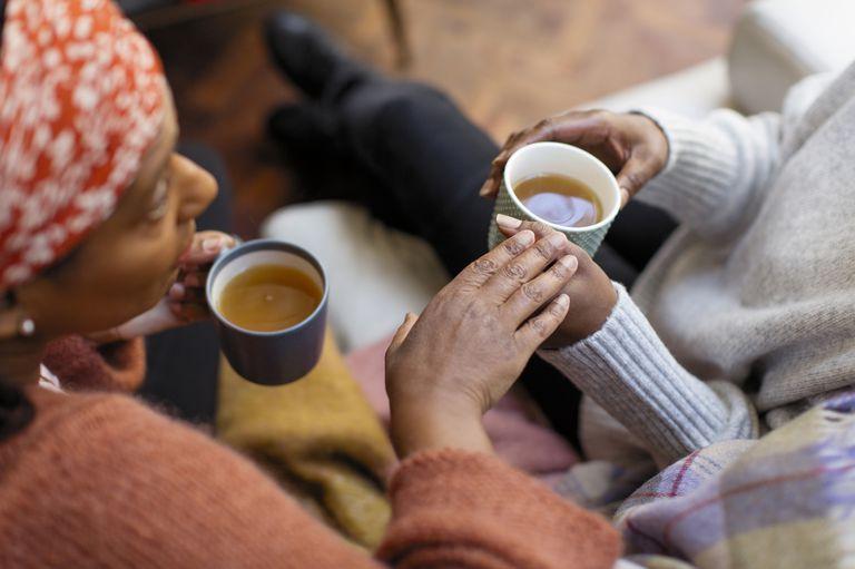 women-friends-talking-drinking-tea-royalty-free-image-948663948-1535640503