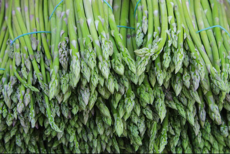 asparagus-selling-in-market-royalty-free-image-870035392-1536154452