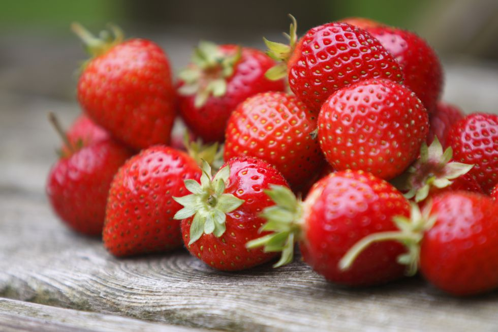 tumble-of-strawberries-royalty-free-image-157643364-1536097292