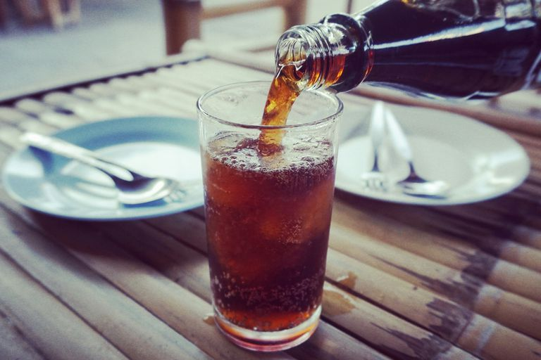 pouring-cola-royalty-free-image-743735729-1536090040