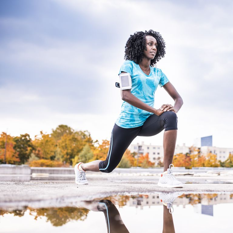 african-american-woman-stretching-before-her-run-royalty-free-image-868150648-1539624231