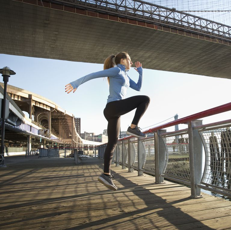caucasian-runner-stretching-on-waterfront-new-york-royalty-free-image-606350053-1539624477