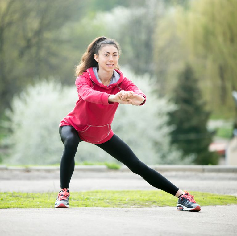 runner-woman-doing-side-lunges-before-jogging-royalty-free-image-531912858-1539624773