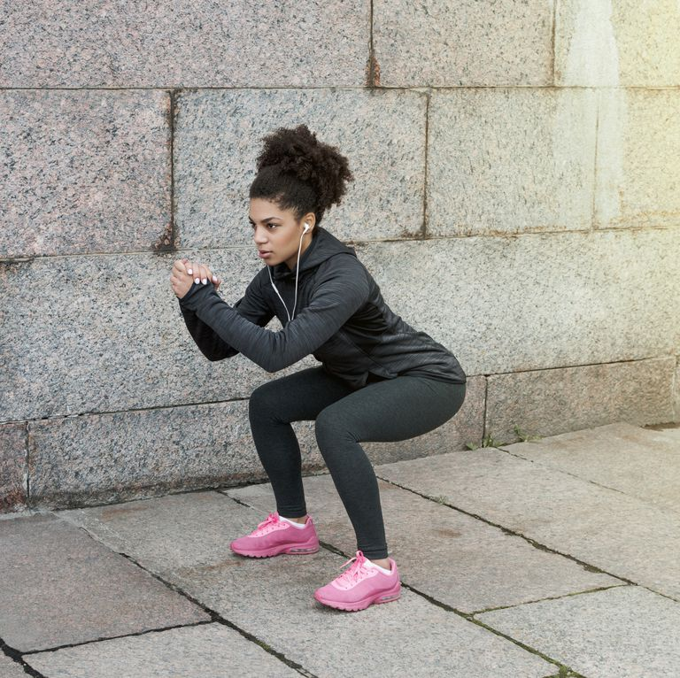 sporty-woman-doing-warm-up-squat-stretching-near-a-royalty-free-image-622324774-1539623109