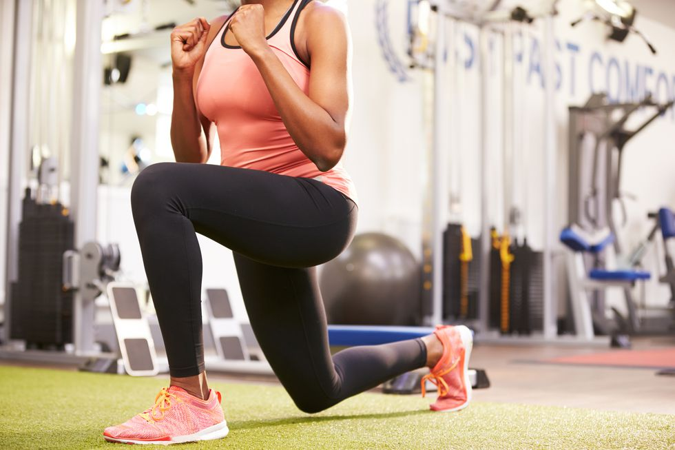 woman-doing-lunges-in-a-gym-crop-royalty-free-image-481448544-1539353478