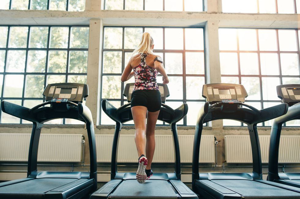 woman-jogging-on-treadmill-royalty-free-image-500228864-1539354565