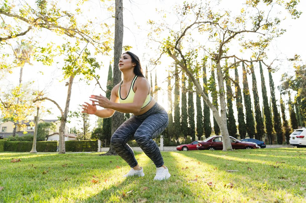 woman-practicing-jump-squats-in-park-royalty-free-image-961085622-1539354328