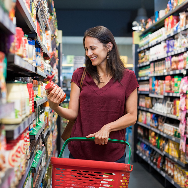 smiling-woman-at-supermarket-royalty-free-image-693280644-1542223979-1