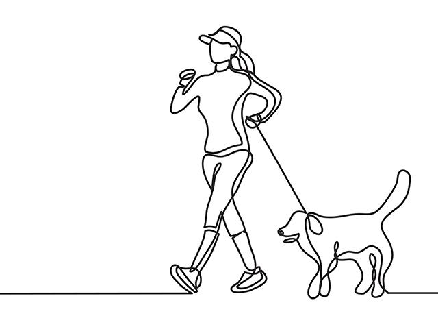 犬を散歩する女性