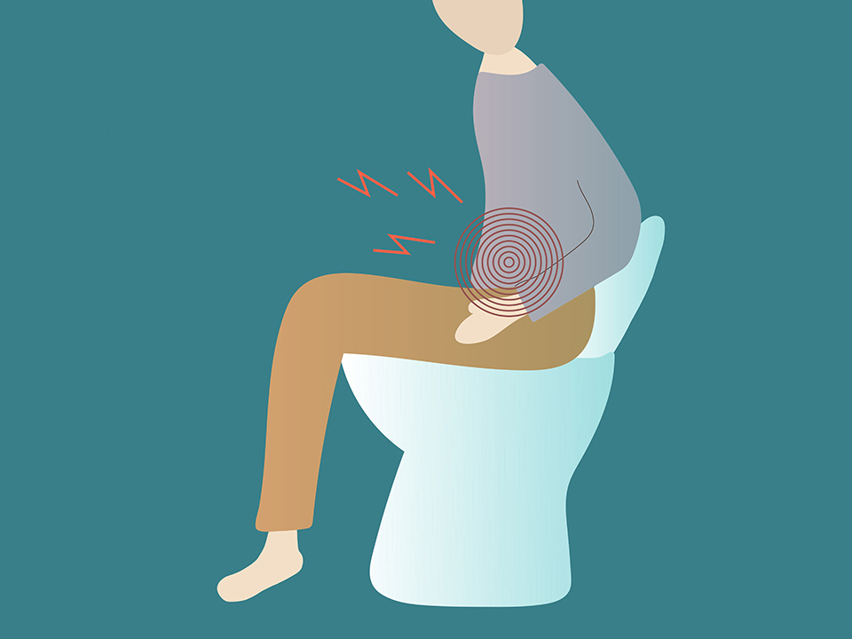 便秘でトイレに座る人