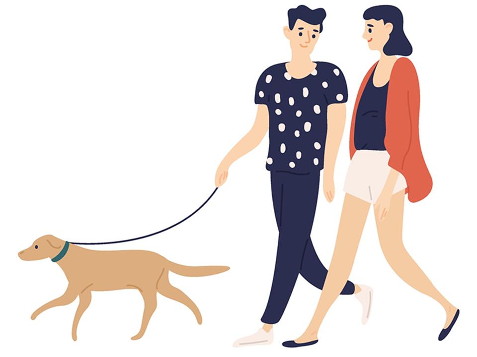 犬を散歩するカップル